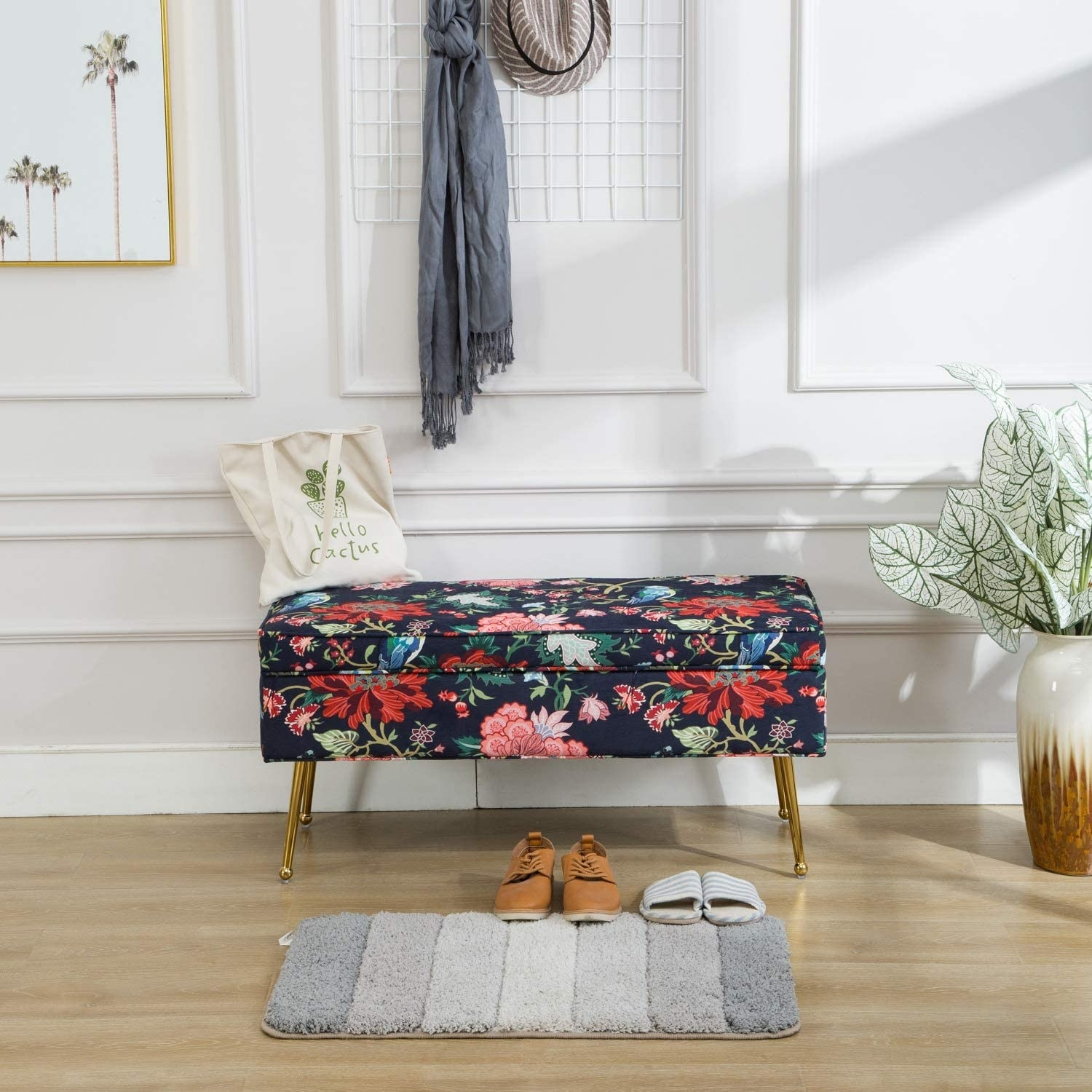 a blue floral bench with gold legs