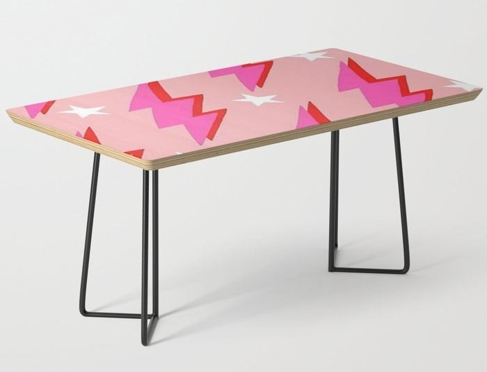 a pink table with a lightning bolt design and black hairpin legs