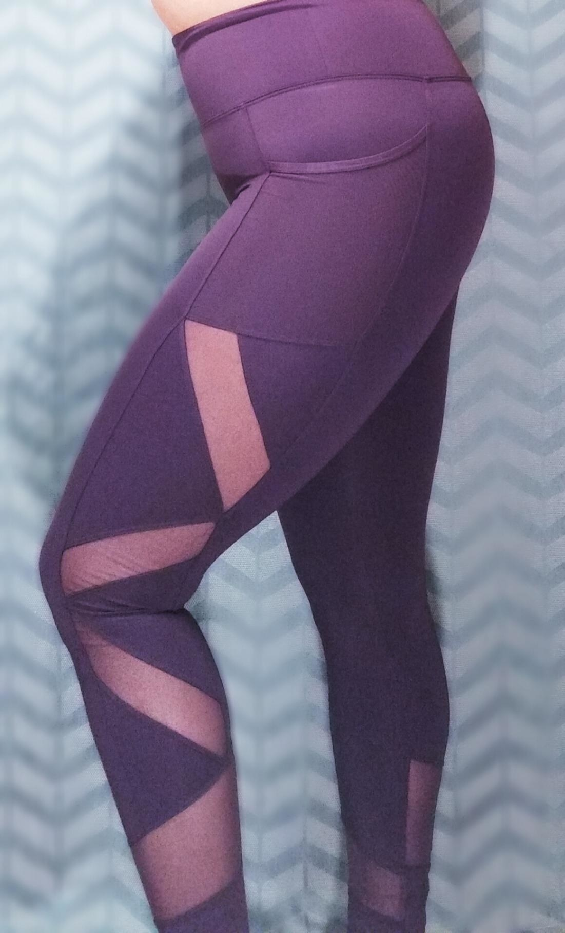 close up of mesh insert details on the grape aurique mesh panel leggings on a reviewer