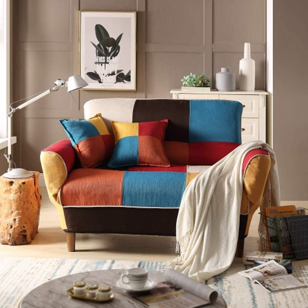 the blue, orange, red, and yellow quilted love seat