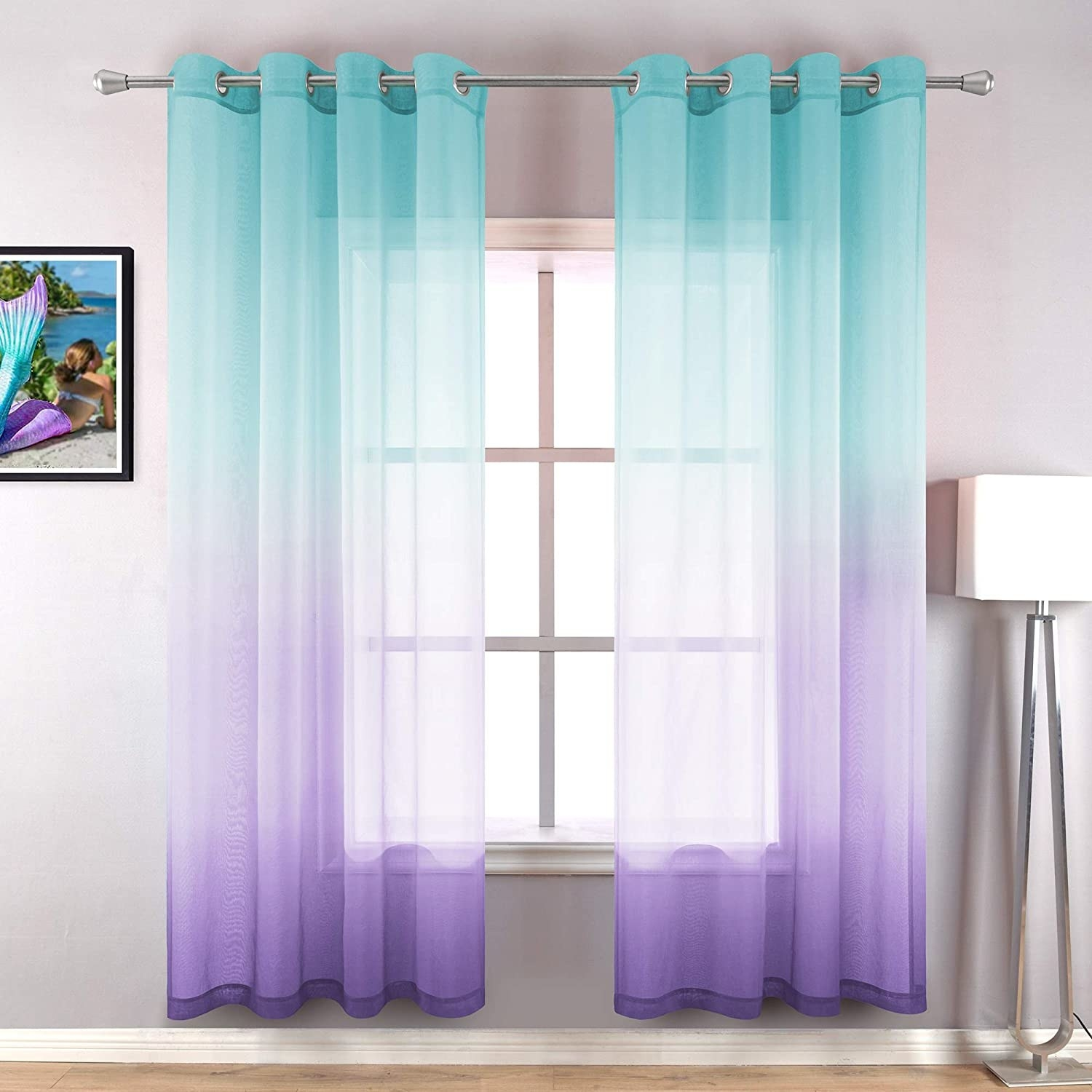 two blue and purple ombre curtain panels hung in a window