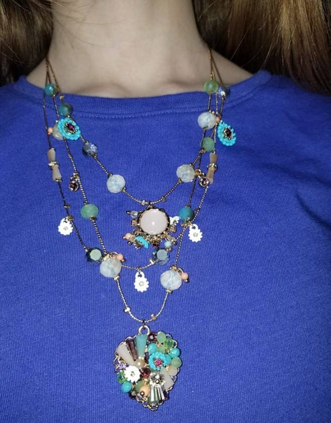 A reviewer wearing the layered necklace