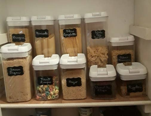 A reviewer showcasing the storage containers in their pantry with food inside of them