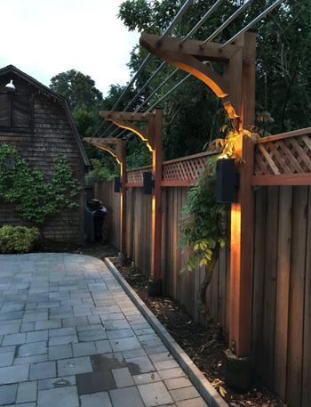 reviewer image of three lights hung on fence poles