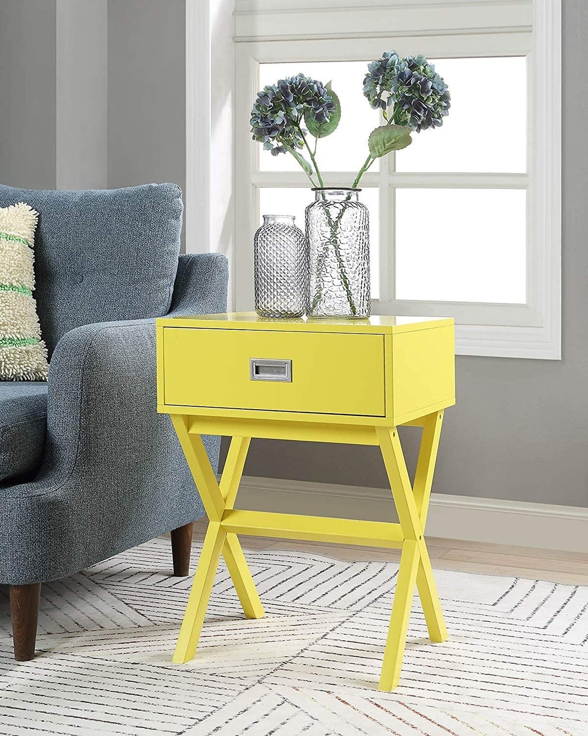yellow one-drawer end table
