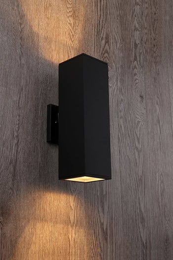 matte black rectangular sconce hung on wall