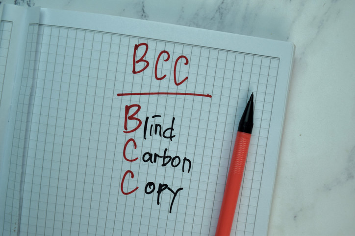 "A notebook with the words ""blind carbon copy"" written on a page"