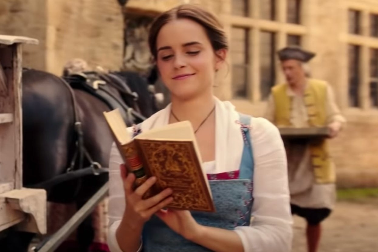 "Emma Watson reading a book and walking down the street as Belle in ""Beauty and the Beast"""