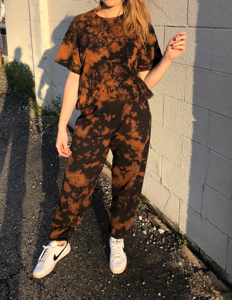 model wears matching brown and black tie-dye T-shirt and sweatpants