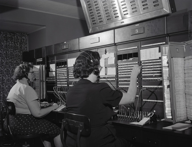 Operators at a 1950s-era telephone switchboard