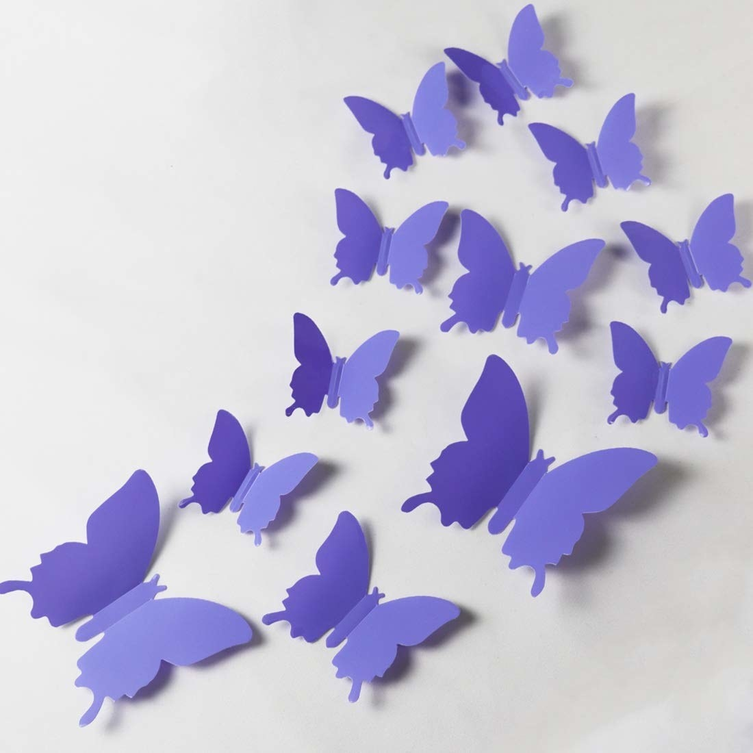 The butterfly decals in purple arranged on a wall