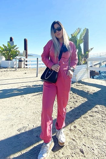 reviewer wears same set in a hot pink color
