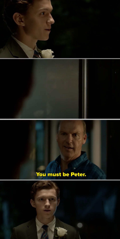 Liz's dad opening his front door to a surprised Peter Parker