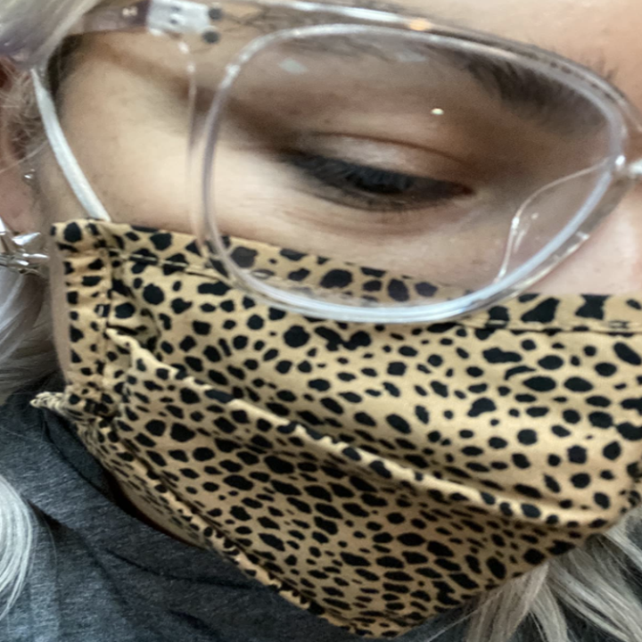 closeup of a person wearing a face mask over mouth and glasses with completely clear lenses