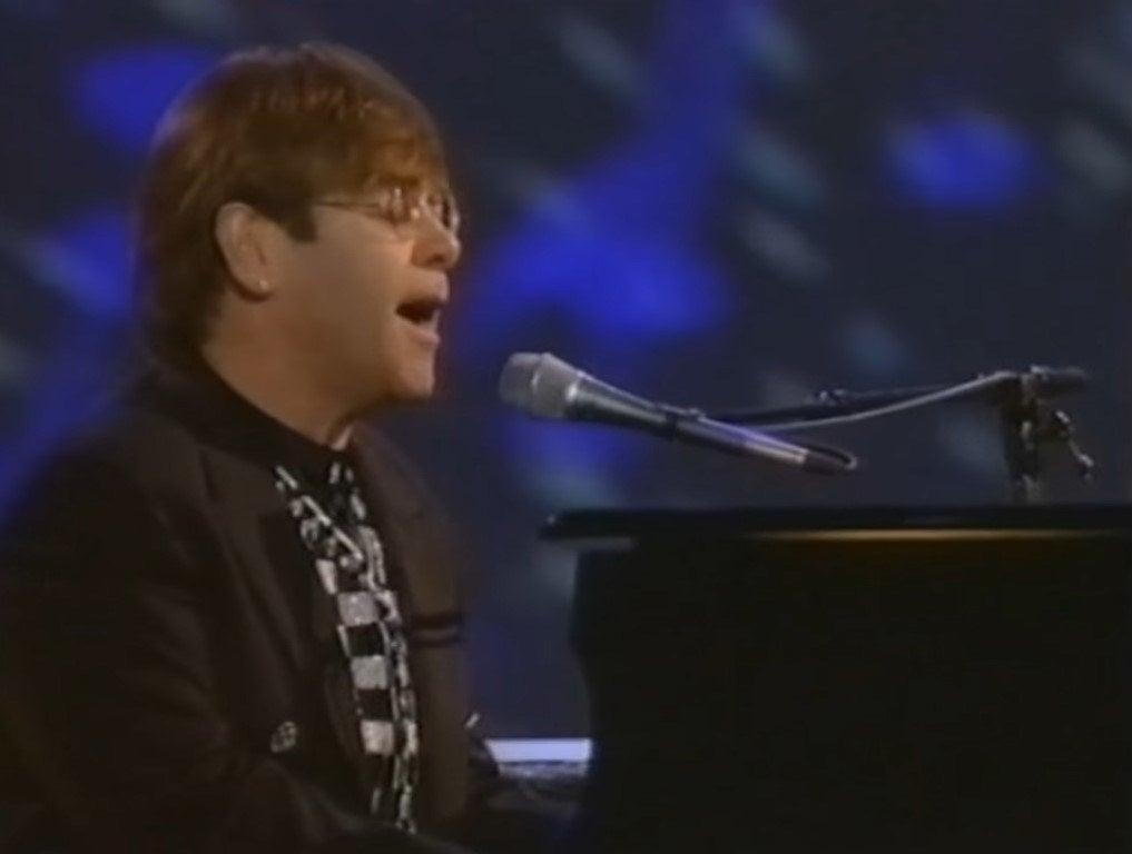 Elton John sitting at the piano