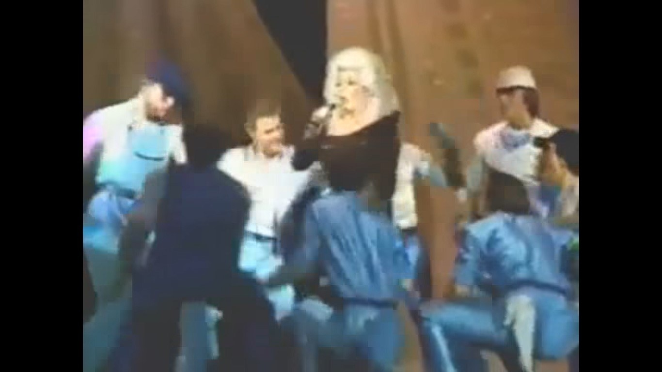 Dolly Parton surrounded by dancers