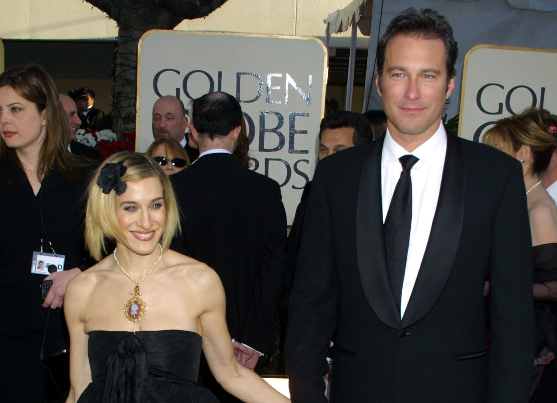 John and Sarah smile at an event