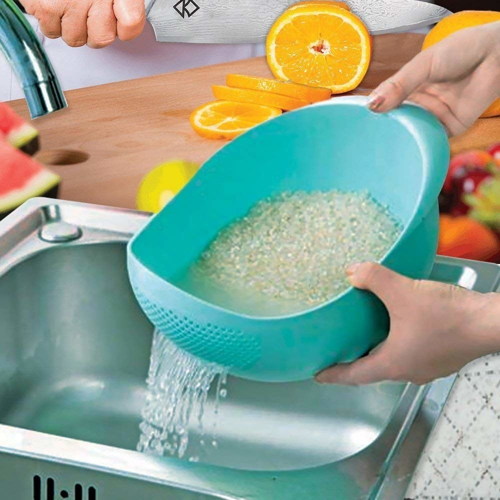 A person using the colander to wash rice