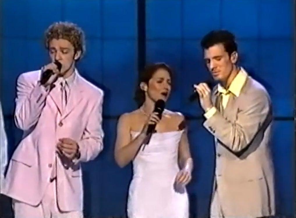 Gloria Estefan singing between Justin and JC Chasez
