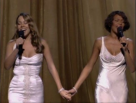Mariah and Carey and Whitney Houston holding hands