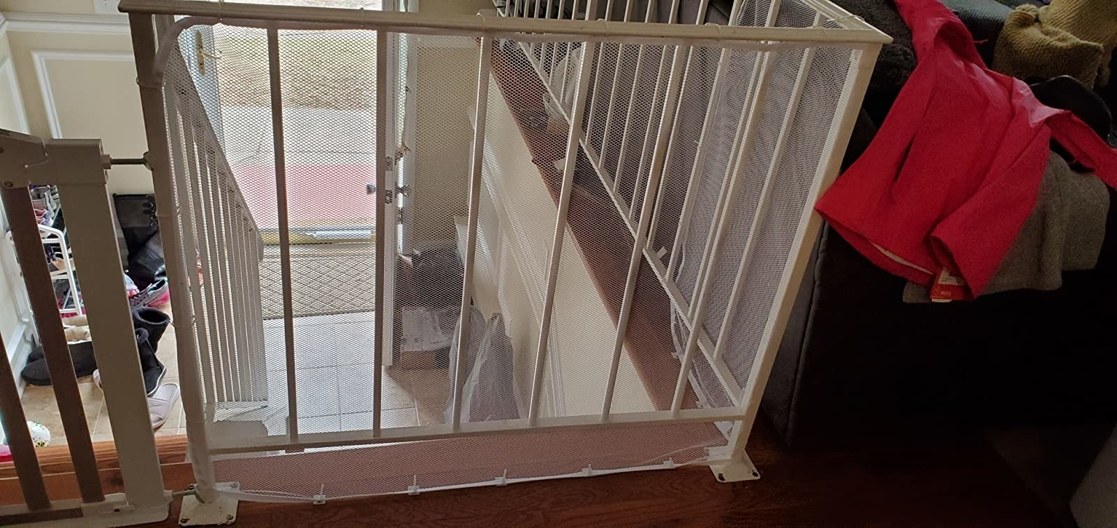 The mesh railing safety net, which ties at the top and bottom of the net, so the pet cannot get between the railings