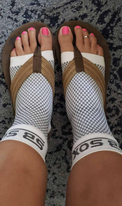 person wearing the foot sleeves with flip-flops