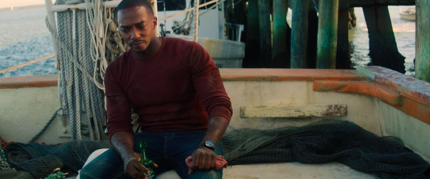 Anthony Mackie holding a Heineken on the boat