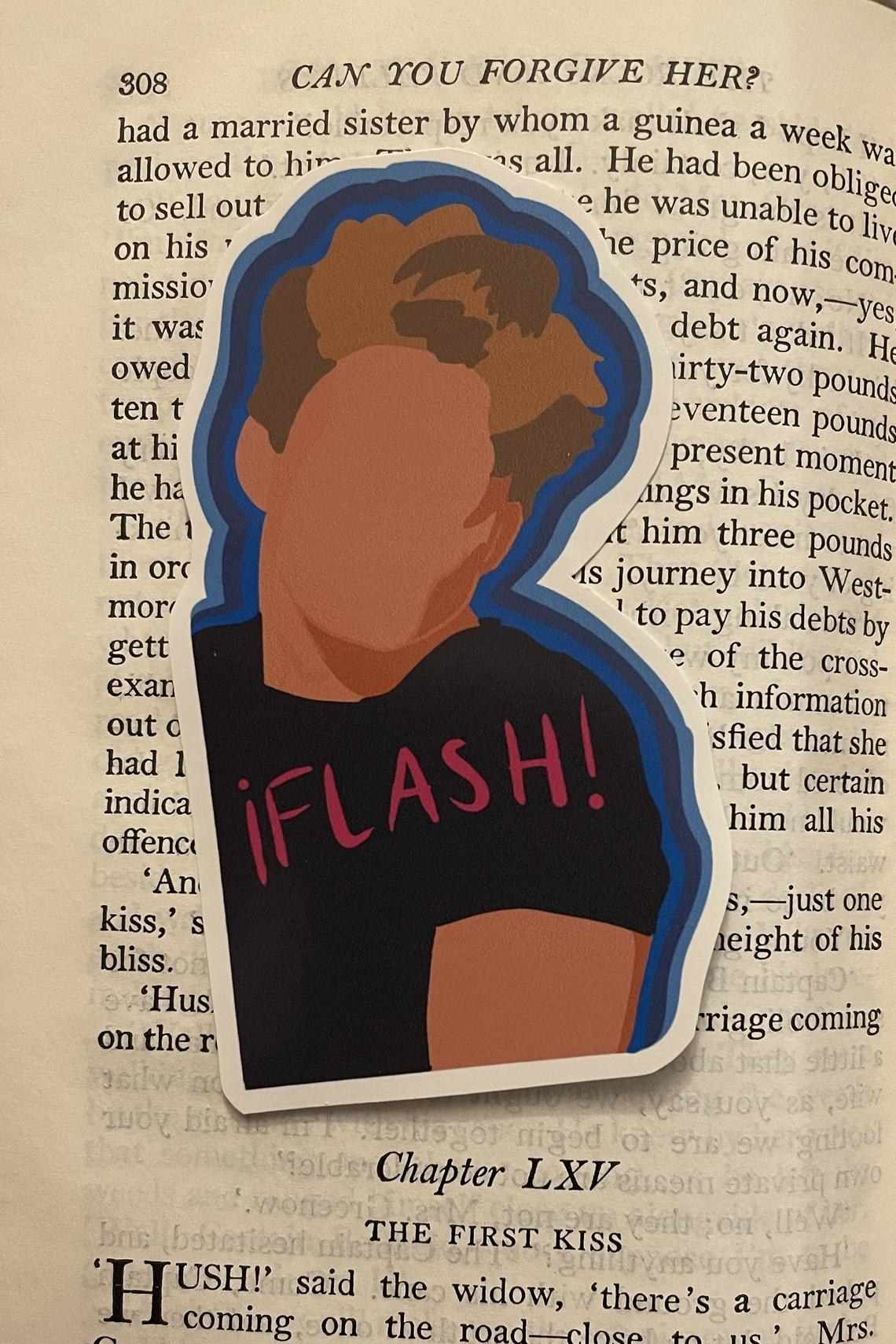 """The Luis Miguel sticker that says, """"Flash!"""" placed in a book"""