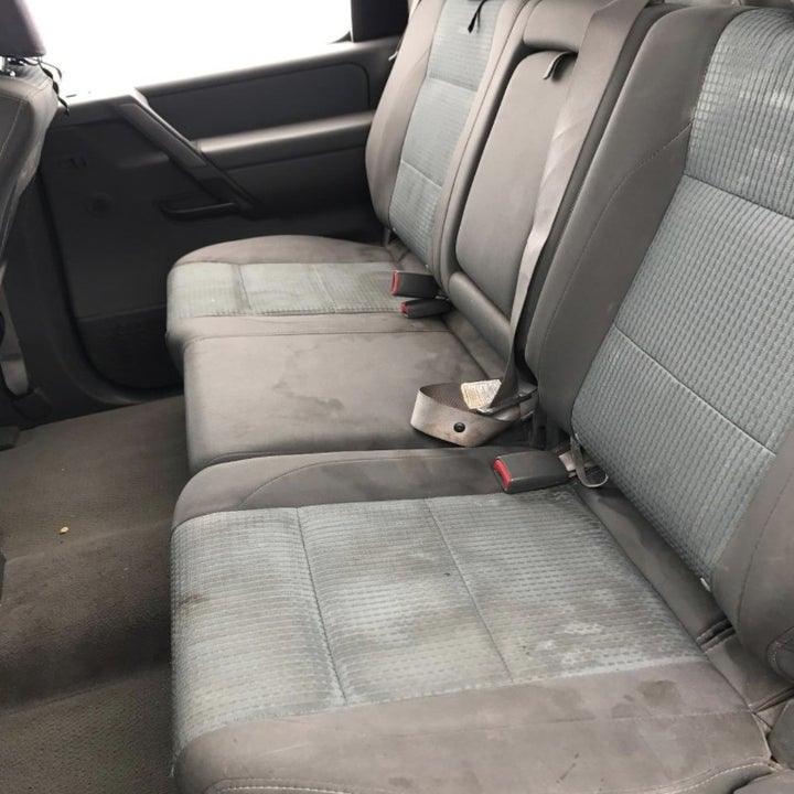 A before picture of a stained car seat