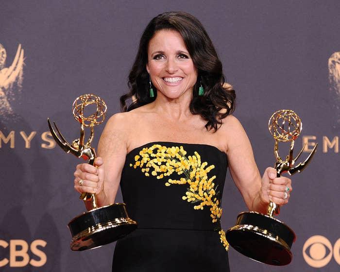 Julia holding two Emmy awards