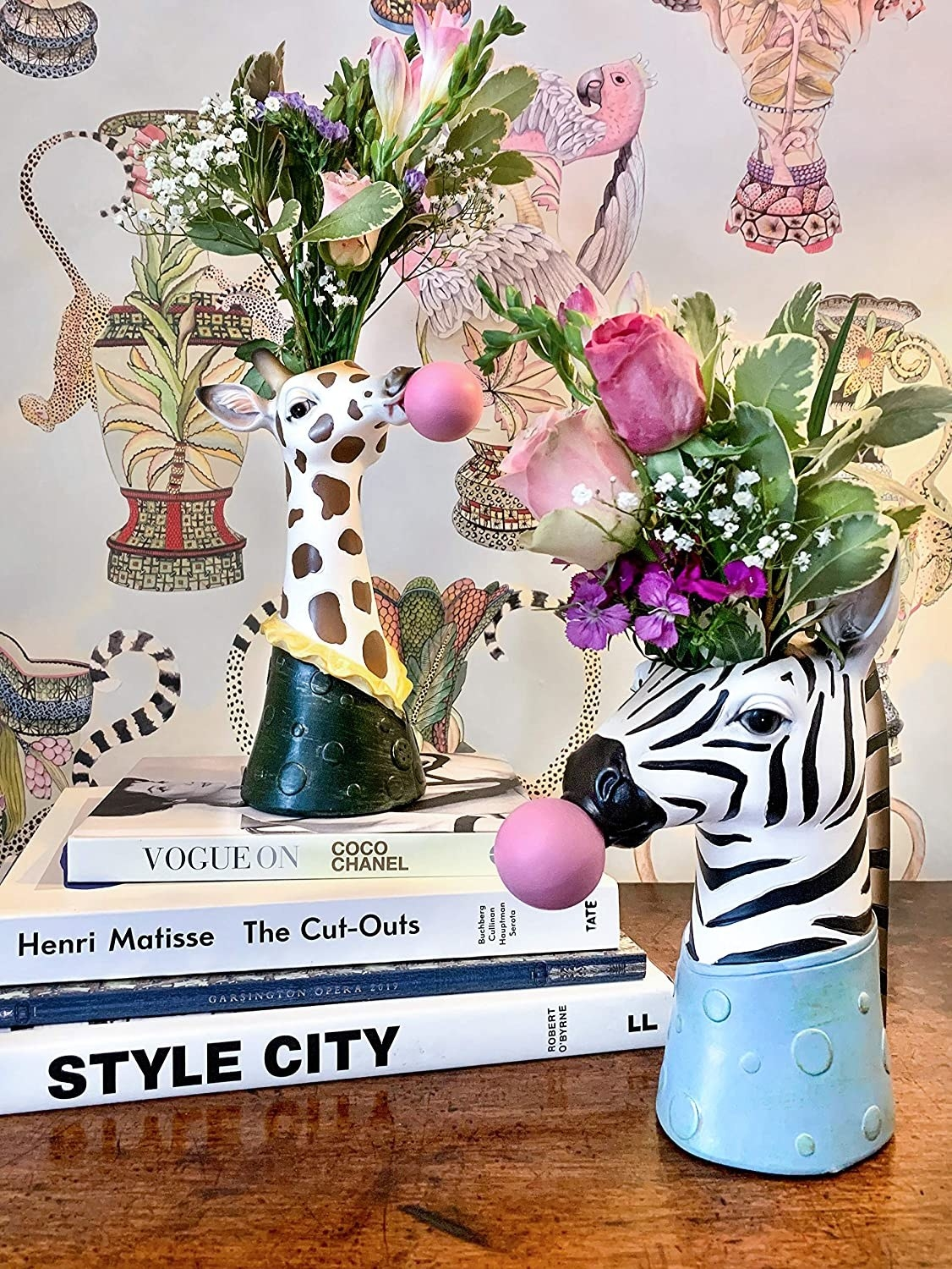 a giraffe and zebra vase