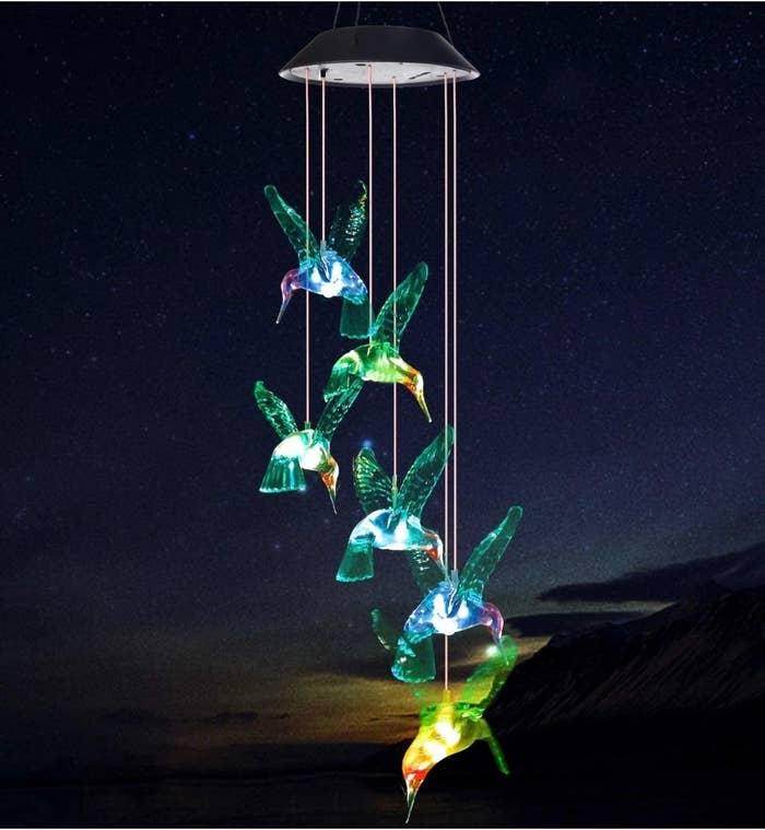 The hummingbird wind chimes against a dark night sky