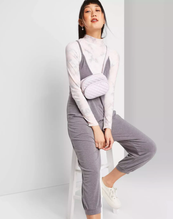 a model wearing the gray slouchy jumpsuit