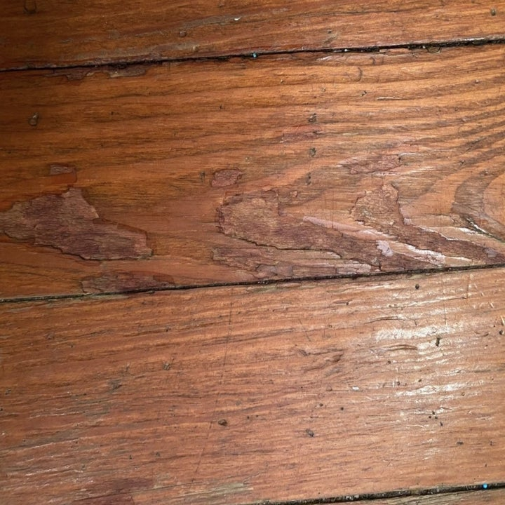 An after photo of wood floor without marks
