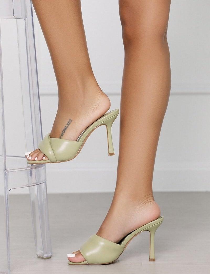 model wearing the slim-heeled mules