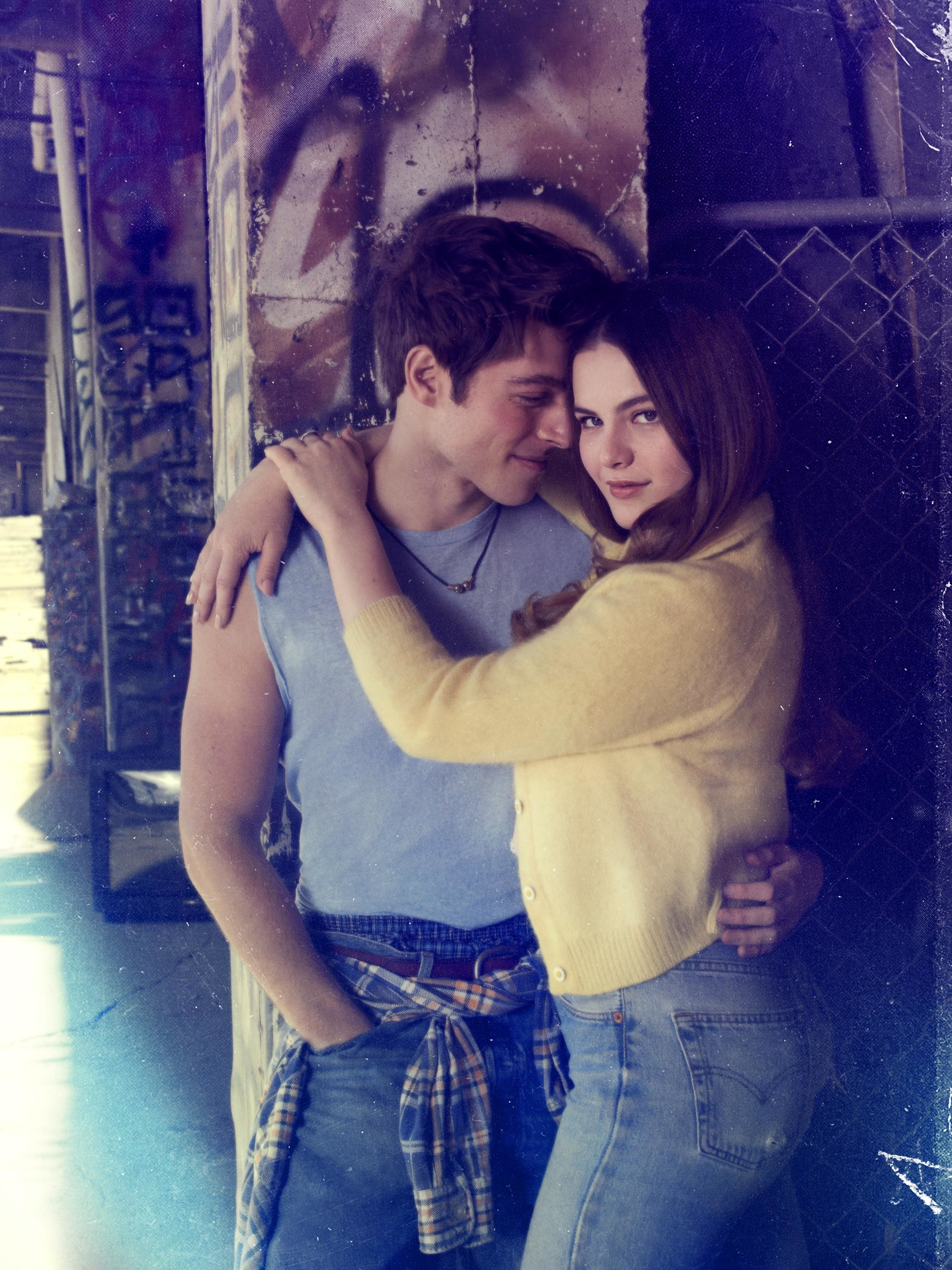 girl with her arms on her boyfriend