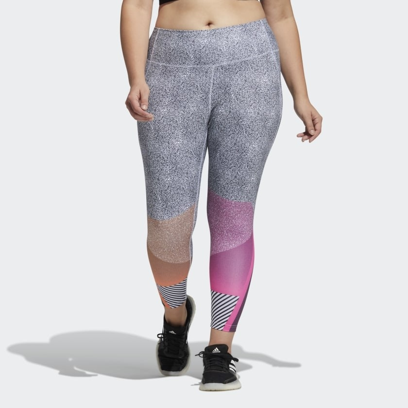 a model wearing the gray leggings with pink and orange patterning on the legs
