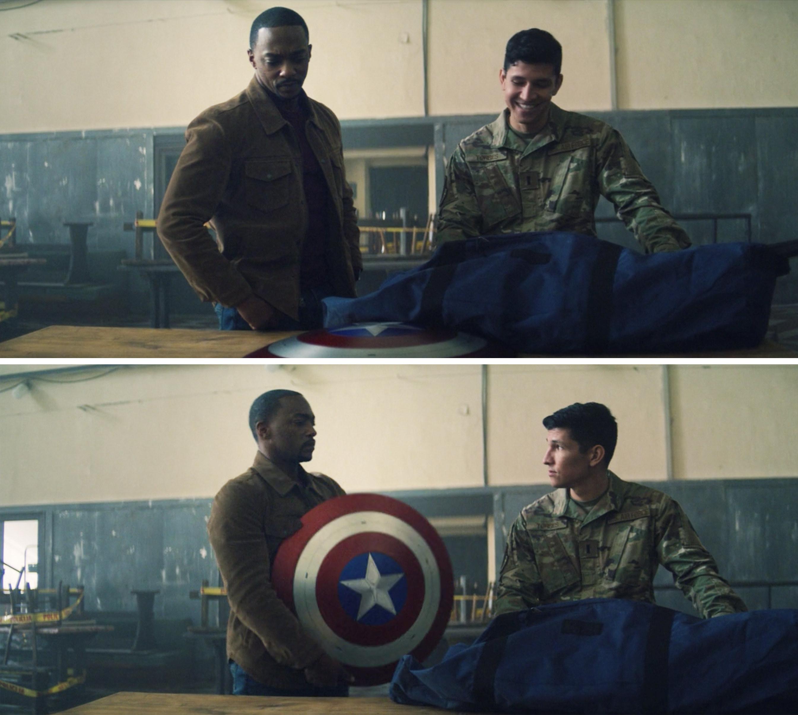 Sam holding the shield and Joaquin looking at him