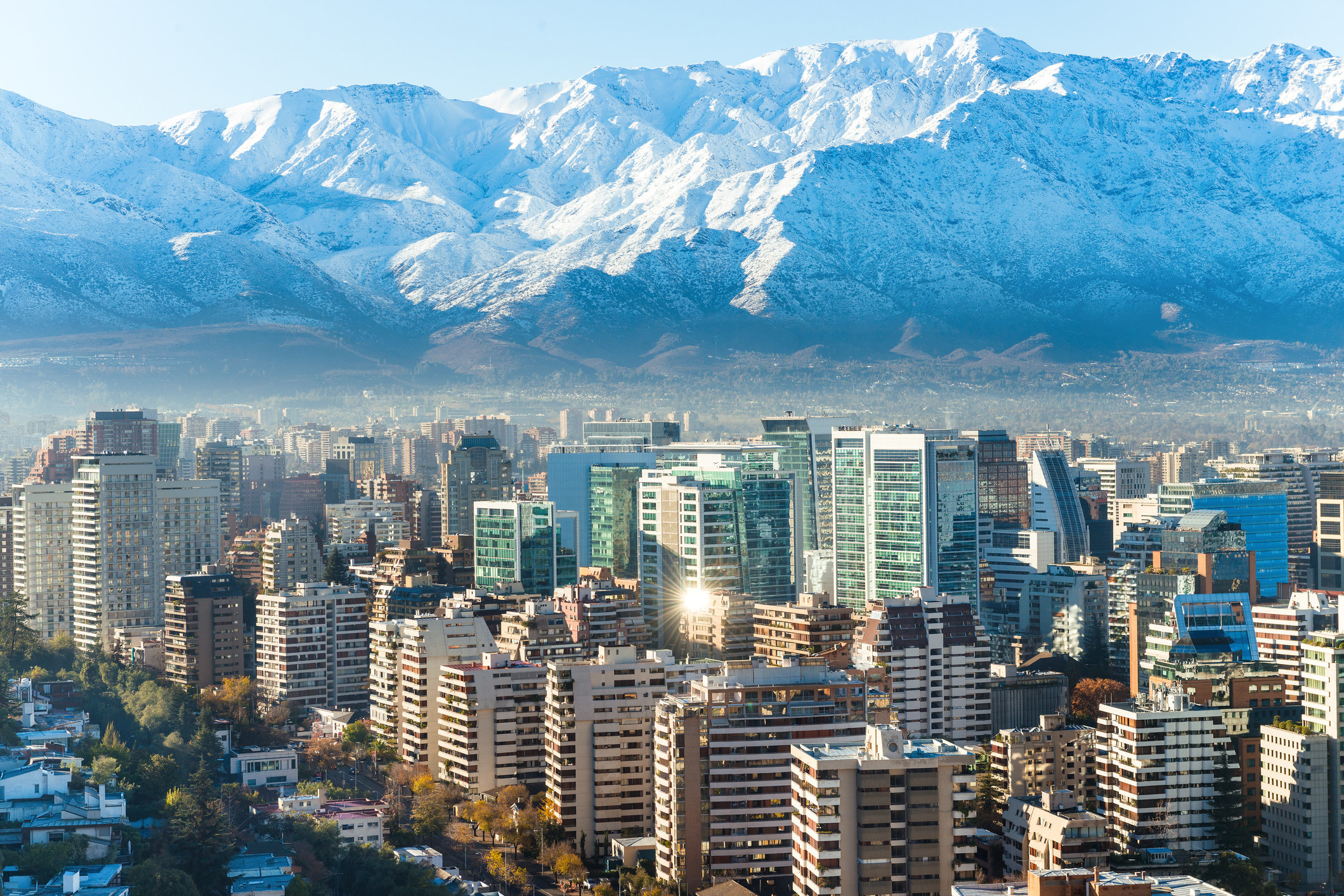 The city of Santiago nestled at the base of the mountains
