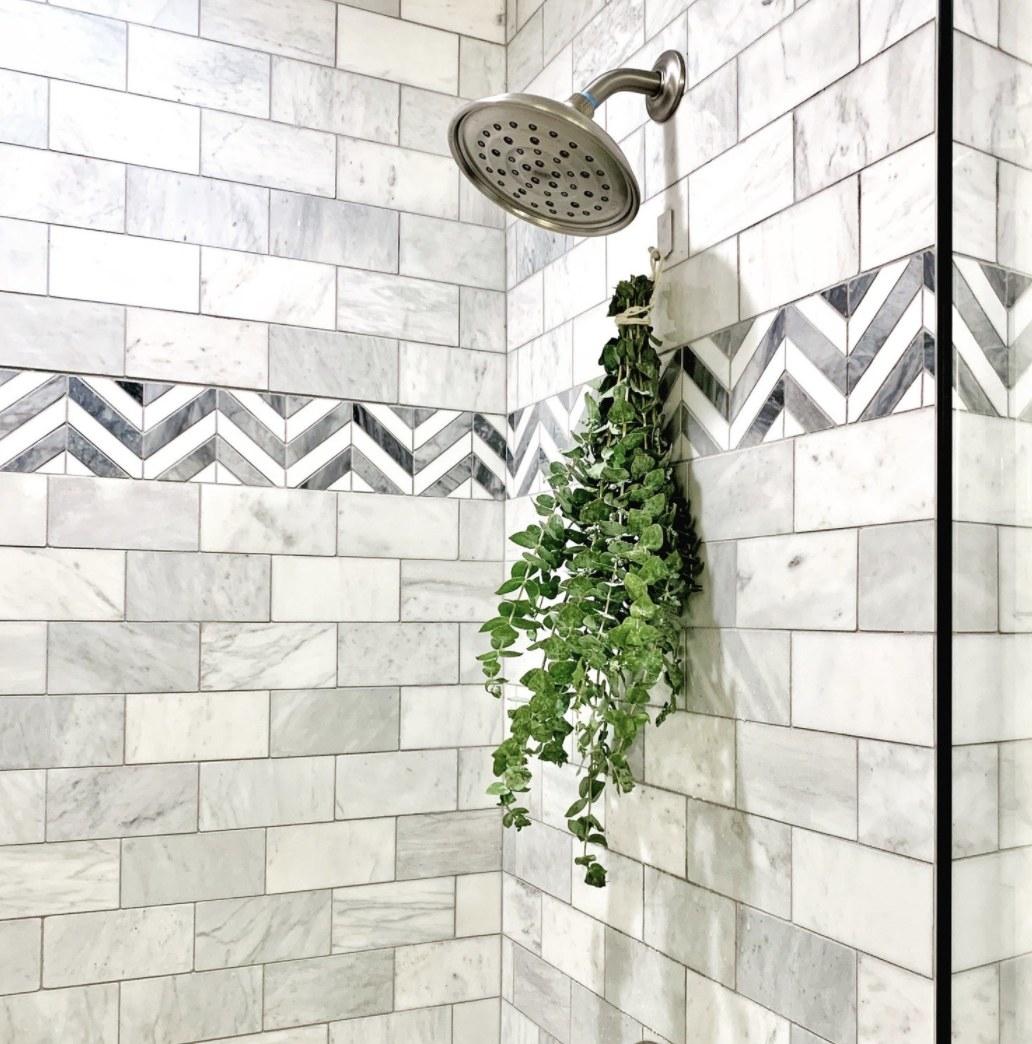 A eucalyptus bunch under a shower head