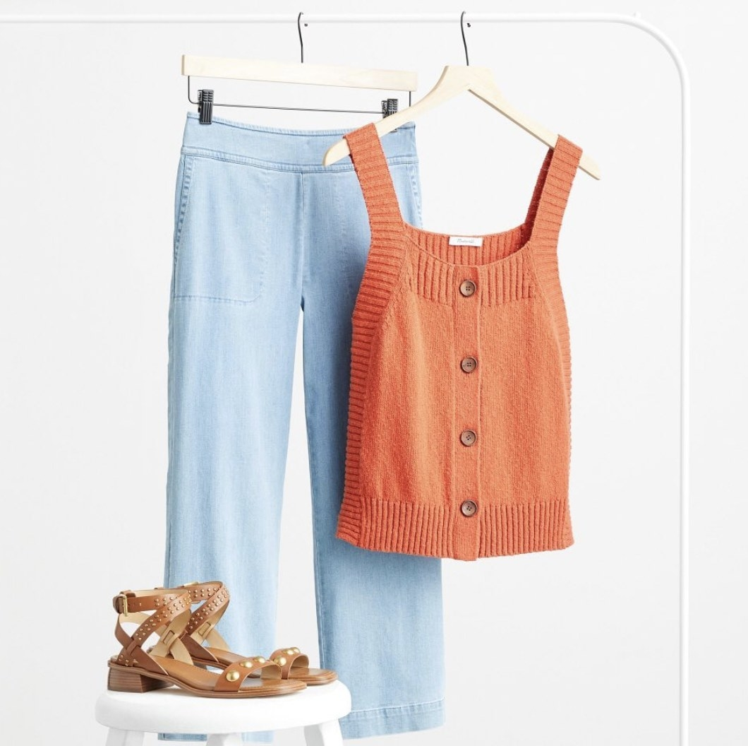A top, pants, and sandals