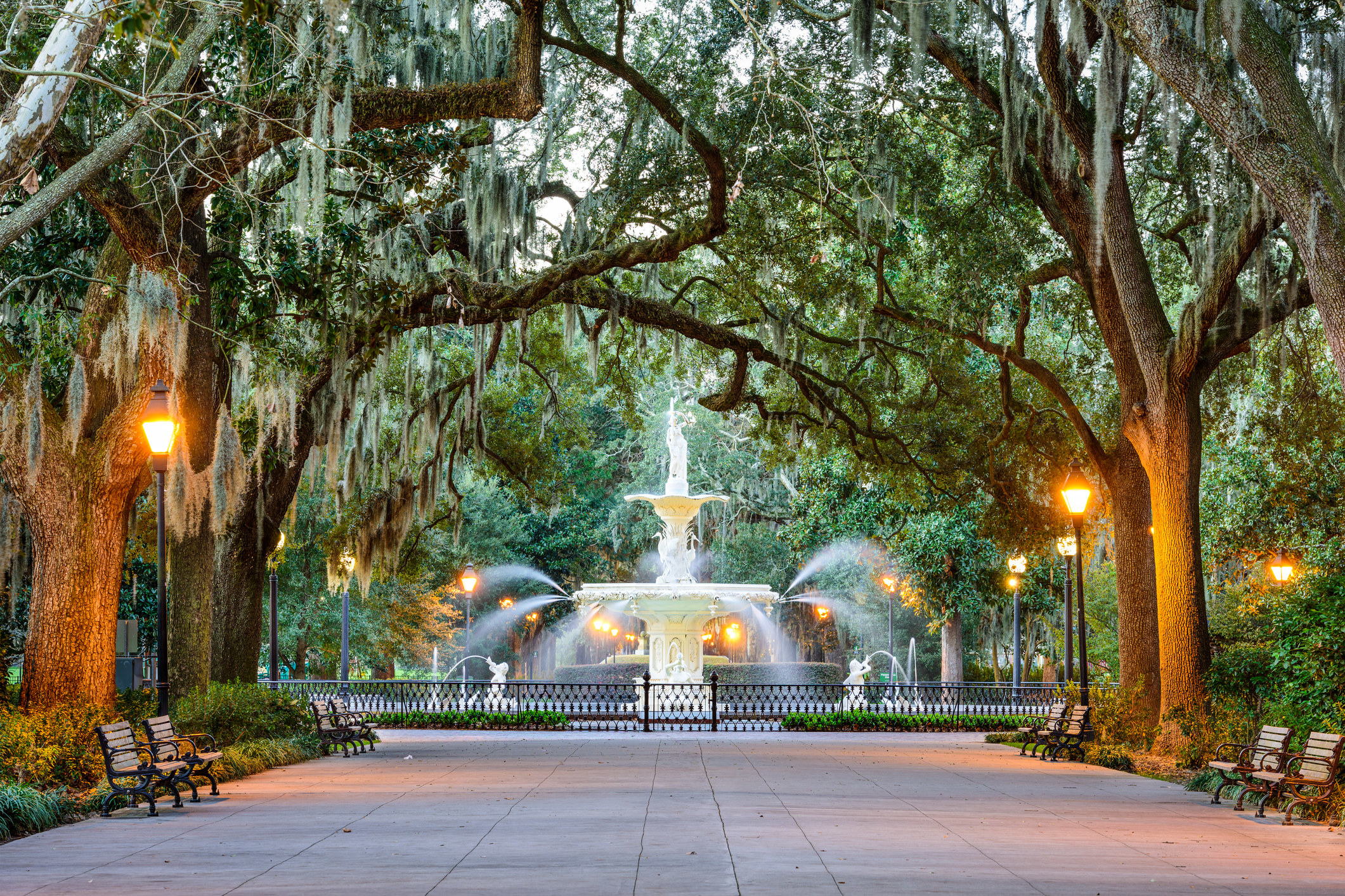 Fountain in a park in Savannah surrounded by trees covered in hanging moss