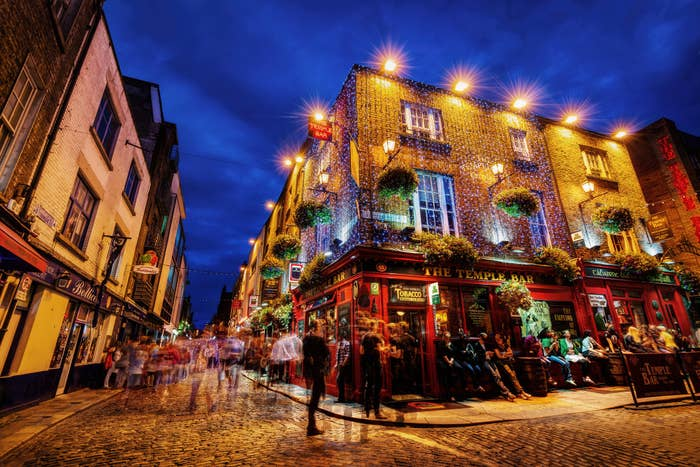 People outside a Dublin pub at night