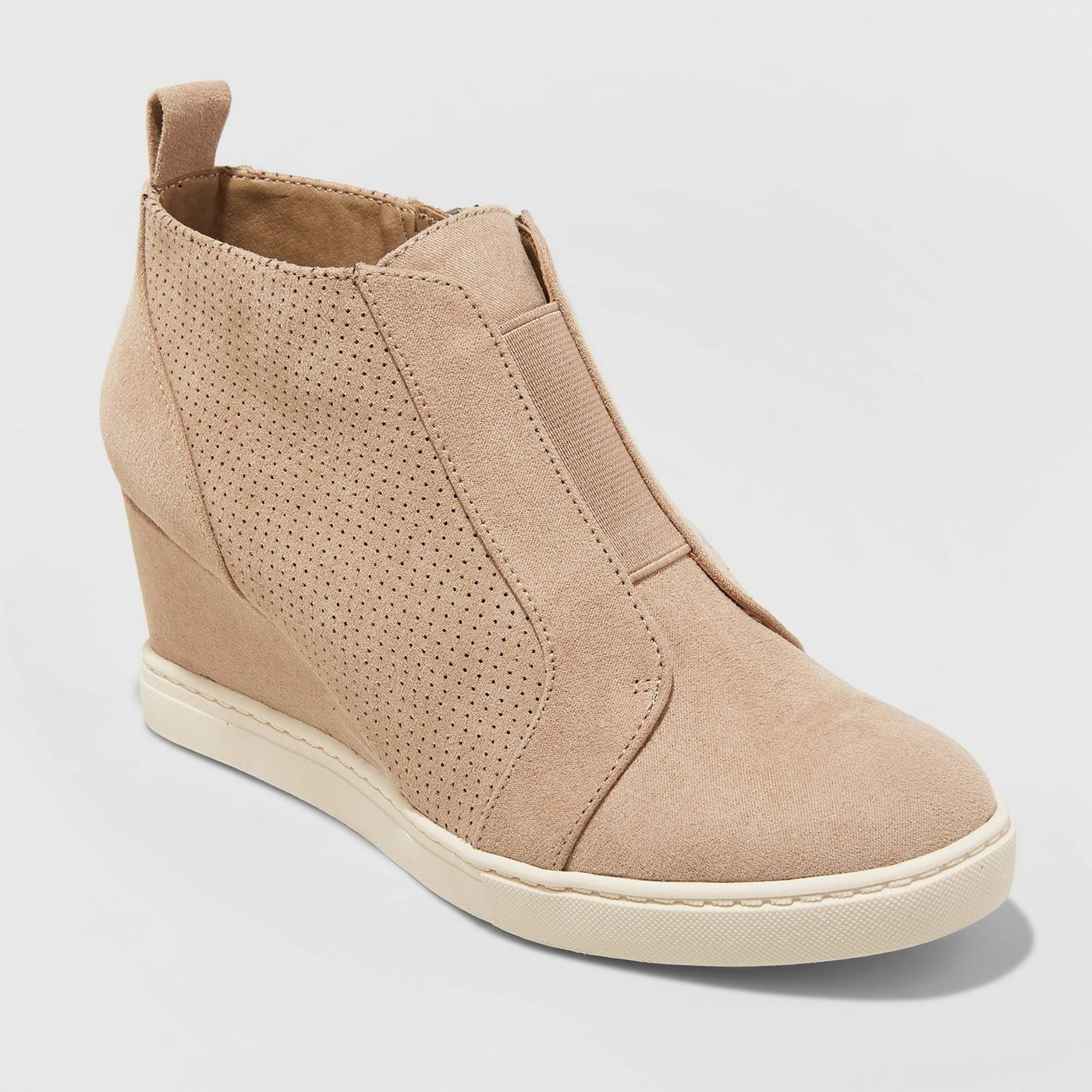 the tan slip on laceless wedges with perforated details