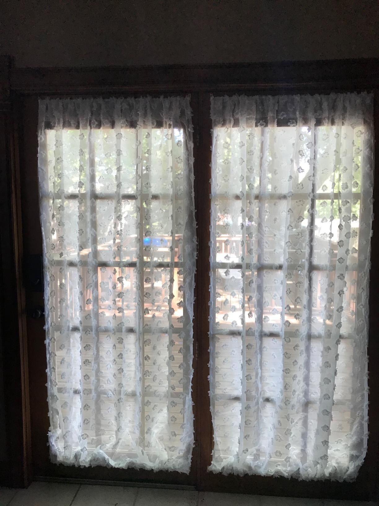 sheer white curtains on french windows