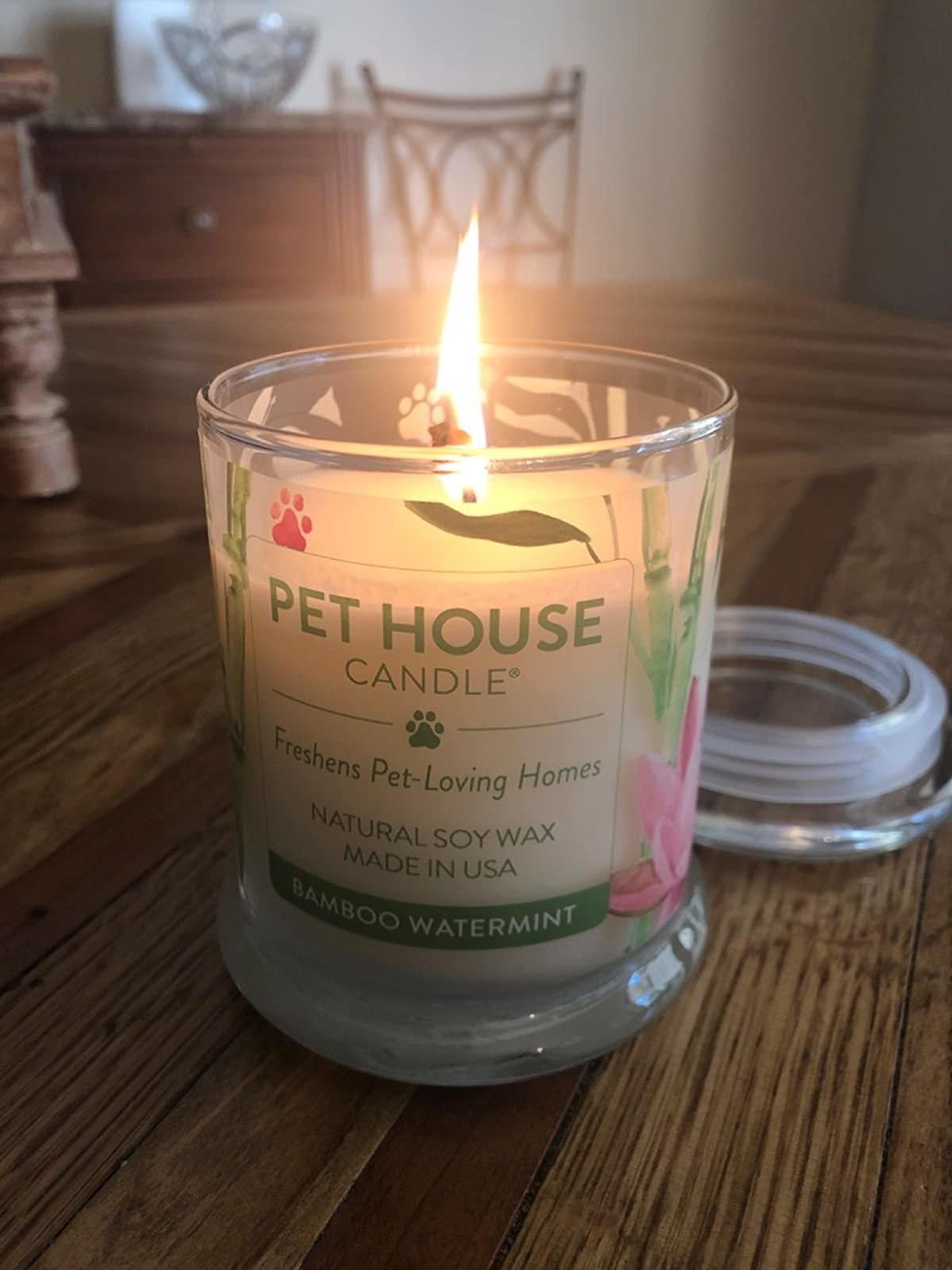 The candle, which comes in a glass jar with a removable top