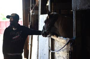 Jamil Prettis with a horse in a stall