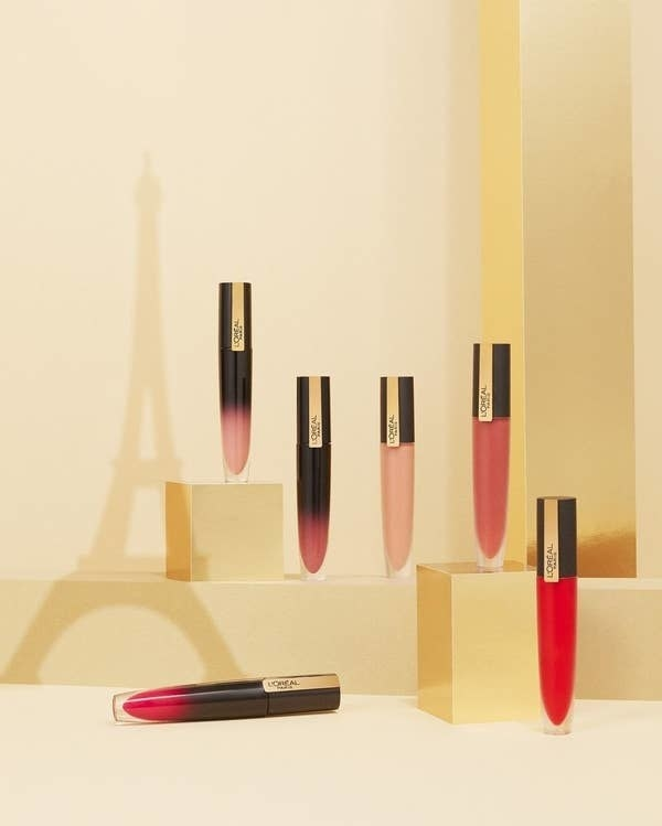 various shades of L'oreal lipstick displayed with eiffel tower shadow in background