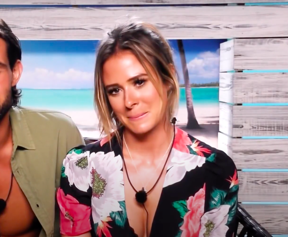 """Camilla from """"Love Island UK"""" holding in an amused expression"""