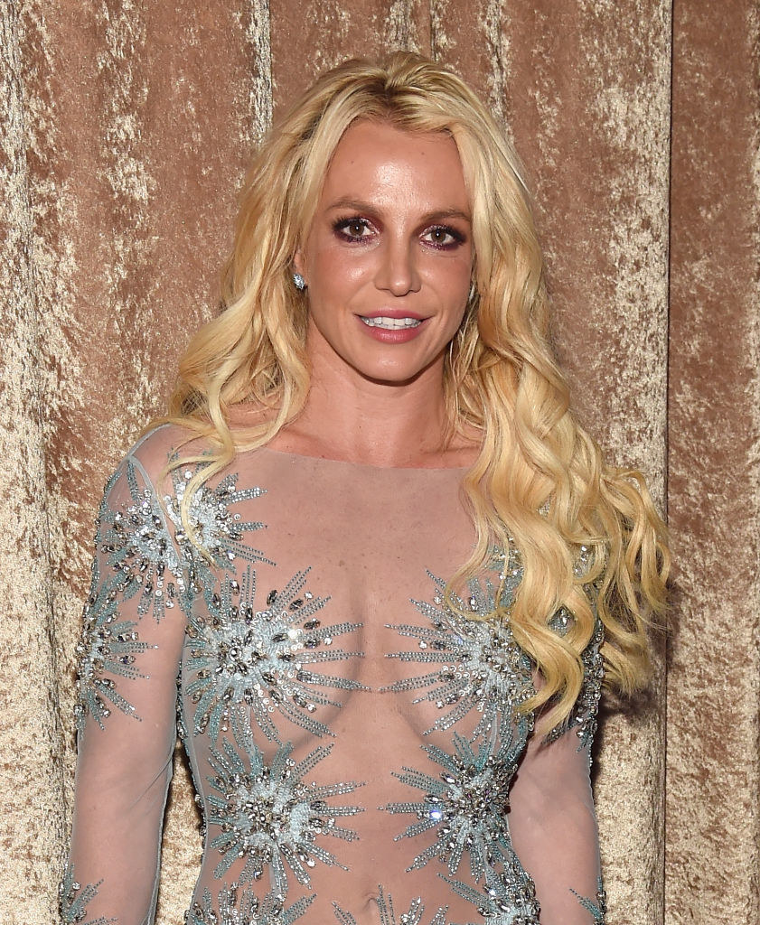 Britney wearing a transparent silvery outfit